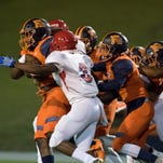 Escambia's Amarqez Moore (10) carries the ball during the Pine Forest v Escambia football game on Friday, September 30, 2016.