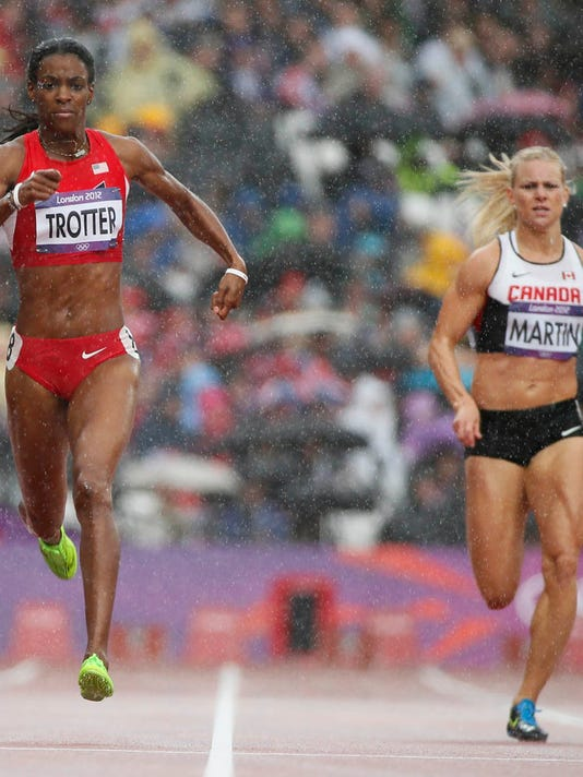 I'm pretty confident I look like Trotter (on the left) when I run in the rain.   DeeDee Trotter (L) of the U.S. and Jenna Martin of Canada run their women's 400m heat in the rain during the London 2012 Olympic Games August 3, 2012.  REUTERS/Lucy Nicholson