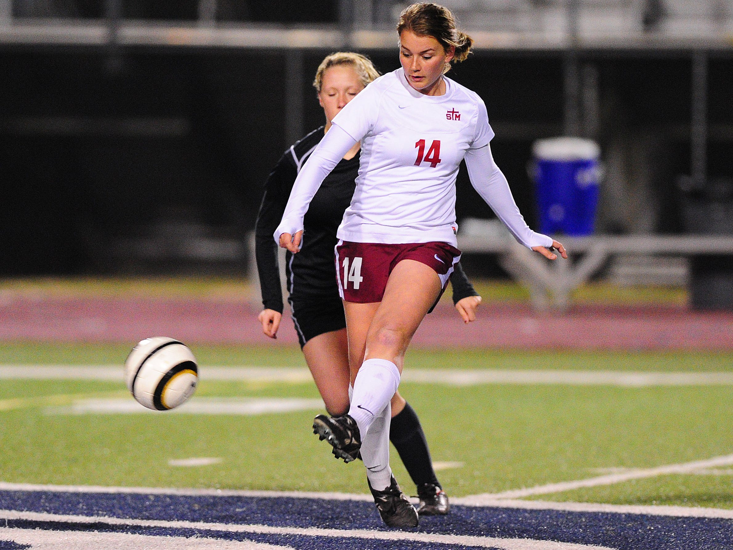 St. Thomas More's Gabby Miller (14) is hoping to finish out her soccer career with the Lady Cougars with a second straight trip to the state finals. STM is hosting two-time defending state champion Ben Franklin at 6 p.m. Friday in the Division II state semifinals.