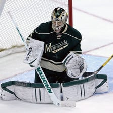Mar 13, 2014; Saint Paul, MN, USA; Minnesota Wild goalie Darcy Kuemper (35) makes a save during the third period against the New York Rangers at Xcel Energy Center. The Wild defeated the Rangers 2-1.
