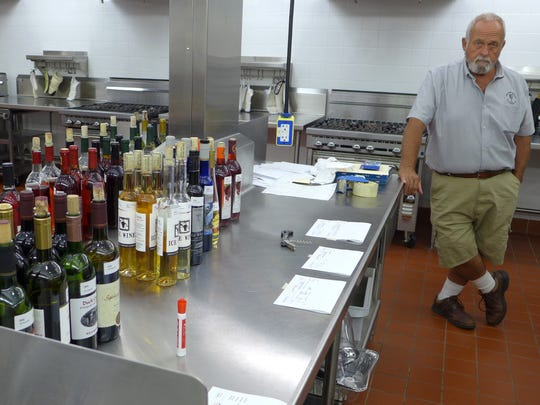 Ervin Paczawski and fellow members of the Wisconsin vintners association worked the back room to make sure the right wines came out at the right time.