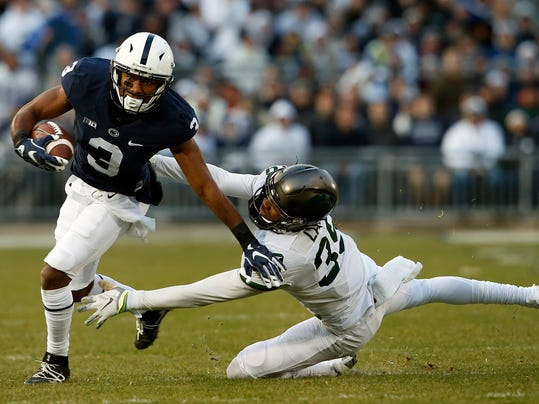 FILE - In this Saturday Nov. 26, 2016, file photo, Penn State's DeAndre Thompkins (3) gets past Michigan State's Justin Layne (39) after a catch during the first half of an NCAA college football game in State College, Pa. No. 6 Wisconsin's opportunistic defense will face a big-play test against No. 7 Penn State in the Big Ten championship game. (AP Photo/Chris Knight, File)