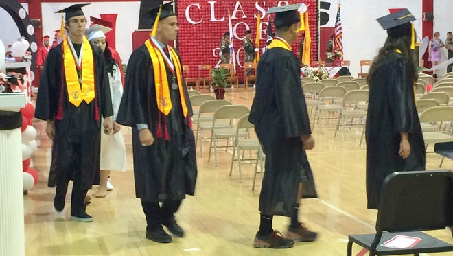 National Honor Society students lead the way at the Cobre High Graduation ceremony in Bayard.