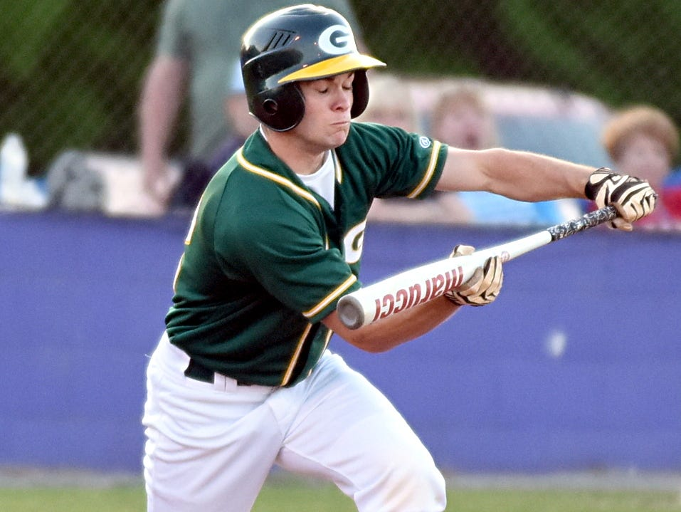 Gallatin High senior Billy Campbell lays down a first-inning bunt. Campbell singled three times, scored three runs, stole two bases and drove in a run in Monday evening's victory.