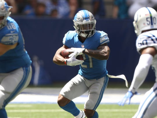 Ameer Abdullah runs the ball against the Colts in an