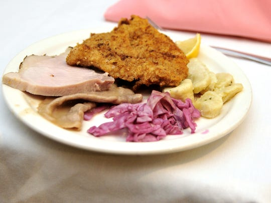 A plate of Austrian fare awaits an event attendee at Michael's Restaurant during the 2014 Austrian Independence Day celebration Friday.
