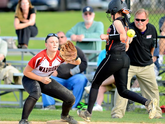Central York's Karly Fink, right, races to first, where