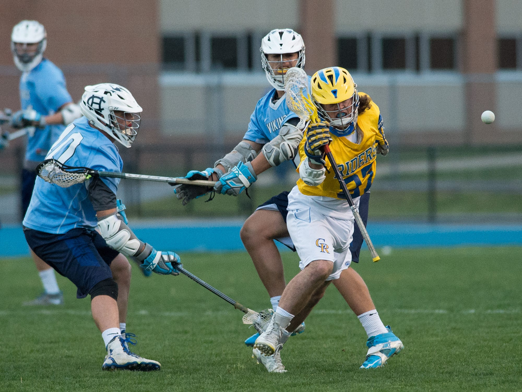 Caesar Rodney's Luke Rankin (27) looses control of the ball in their home game against Cape Henlopen.