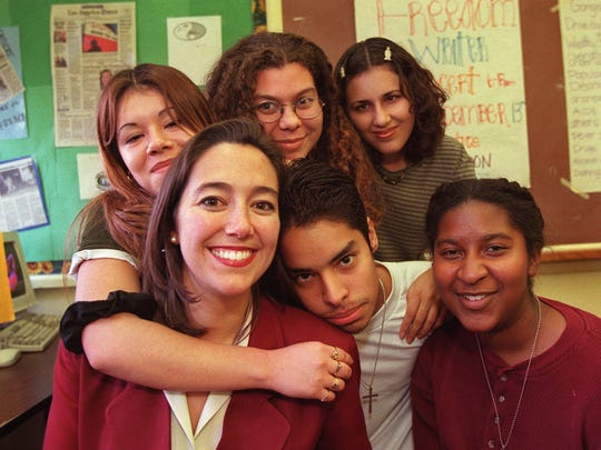 High School teacher Erin Gruwell, left, poses with a few of her English students, clockwise from top left, Maria Reyes, 17, Sue Ellen Alpizar, 18, Tony Becerra, 17, Gency Cruz, 18, and Kelly Johnson, 17, at Woodrow Wilson High School on Wednesday, Dec. 3, 1997, in Long Beach, Calif.  (AP Photo/Mark J. Terrill)
