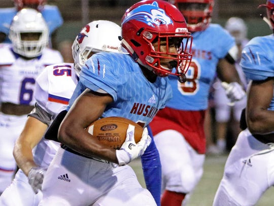 Hirschi's Nathan Downing runs after catching the punt