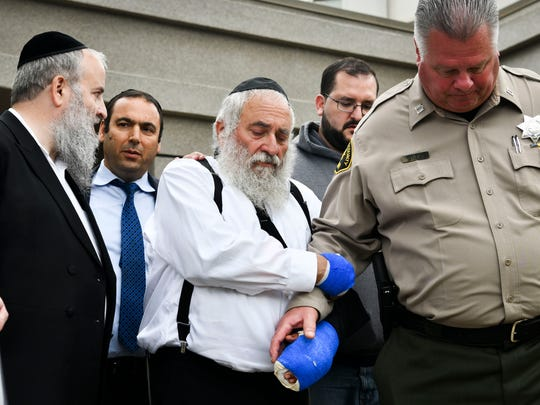 Rabbi Yisroel Goldstein leaves his church after speaking at a press conference in front of Chabad of Poway synagogue April 28. 2019. One woman was killed and three others were wounded when a man entered a synagogue during Passover services Saturday at the Chabad of Poway temple and opened fire with an AR-style assault weapon.