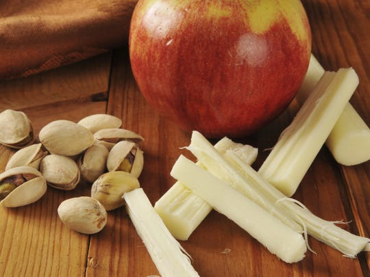 "Instead of packaged ""diet"" snacks often high in sugar and additives, try a handful of nuts, some string cheese and apple slices."