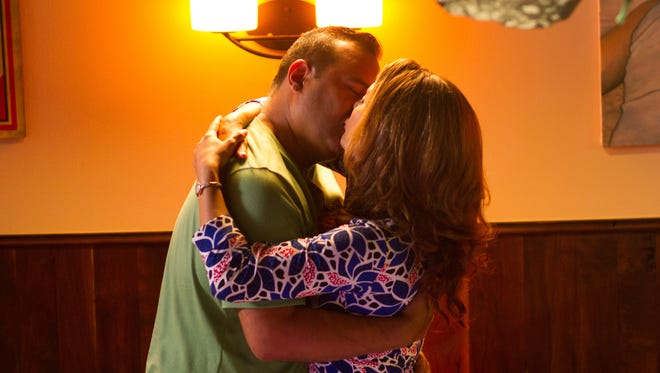 """Debbie (Alex Meneses) and Harris (Russell Peters) reconnect in """"Ripped."""""""