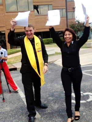 The Rev. Chris Jimmerson, left, Minister for Program Development at First Unitarian Universalist Church of Austin, and asylum seeker  Sulma Franco, celebrate Franco's receiving a delay of deportation in August.