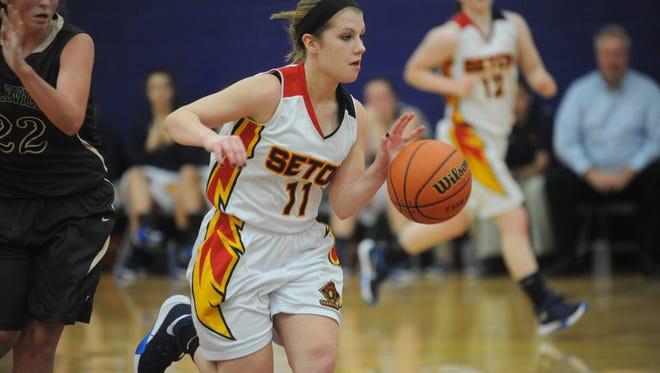 Seton Catholic's Megan Schroeder dribbles past Daleville's Madison Savage during Monday's game.