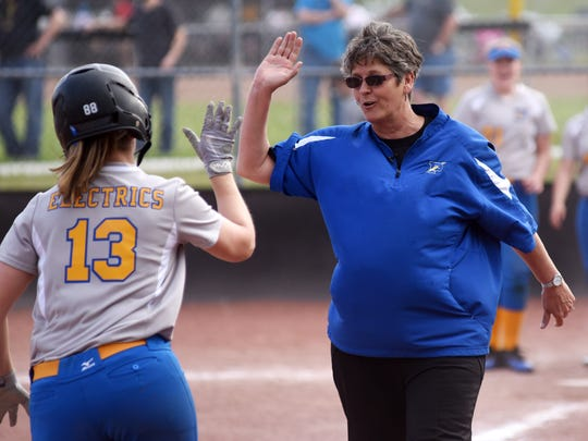 Philo High School softball coach Michelle Moyer congratulates Corin Tom after she hit a home run in the TR file photo. Last week the  Ohio High School Fastpitch Softball Coaches Association named Moyer the Sportsmanship, Ethics and Integrity Award winner for 2020.