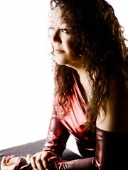 Vocalist Rhonda Head performs Friday night during the