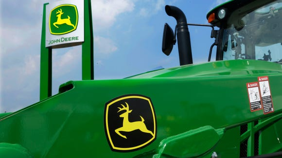 In this Monday, Aug. 31, 2015, file photo, John Deere equipment is on display at the Farm Progress Show in Decatur, Ill.
