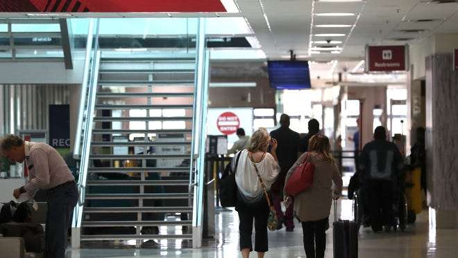 People walk through the security checkpoint at Tallahassee International Airport on Monday, Oct. 30, 2017.