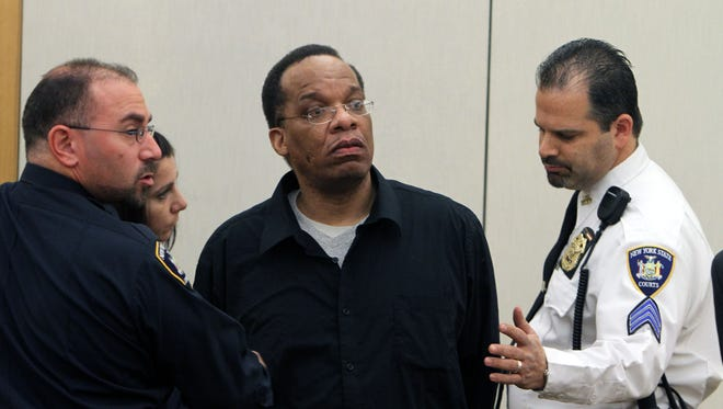 Selwyn Days is escorted out of the courtroom after Judge Barry E. Warhit sentenced him to two consecutive 25-years-to-life terms in prison at the Westchester County Courthouse in White Plains on Dec. 20, 2011.