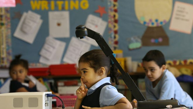 Kindergartner, Camila Sanchez-Gonzalez, prepares her classmates for going over a journal entry she made that included a picture and writing at  the Eugenio Maria de Hostos Charter School 9.