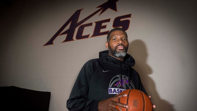University of Evansville head coach Walter McCarty poses for a portrait at Meeks Family Fieldhouse on Friday, March 23, 2018. McCarty, an Evansville native was announced as the new basketball coach Thursday.