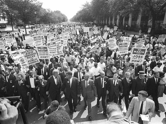 "Civil rights leader Martin Luther King (third from left) walks with supporters during the ""March on Washington"" on August 28, 1963, after which, King delivered the ""I Have a Dream"" speech from the steps of the Lincoln Memorial."