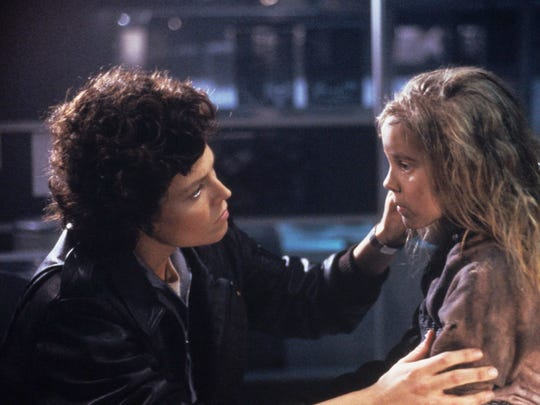"""In """"Aliens"""" (1986), Ellen Ripley (Sigourney Weaver) turns into a bona fide action hero as she returns to the alien planet with space marines, where she finds a shell-shocked little girl named Newt."""