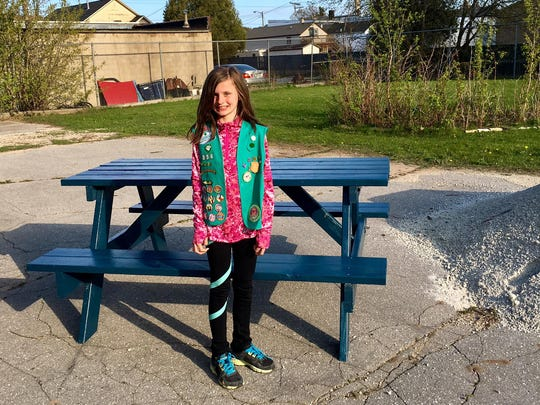 Girl Scout Troop 8543 earned its Bronze Award this past spring. The girls chose to donate a picnic table to The Haven. Pictured is Aliyah Hanson.
