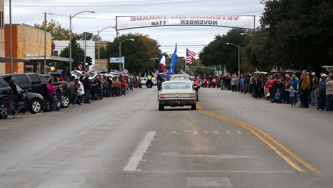 "Spectators line Beauregard Street to watch the 14th annual Veterans Day Parade themed ""Salutes American Heroes,"" move through downtown San Angelo, Saturday, Nov. 11, 2017."
