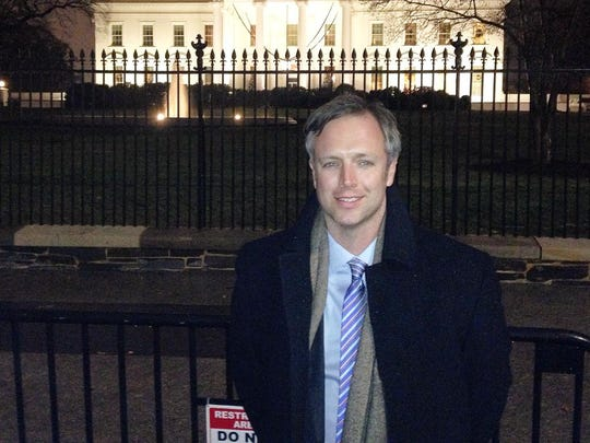 William Dissen in front of the White House.