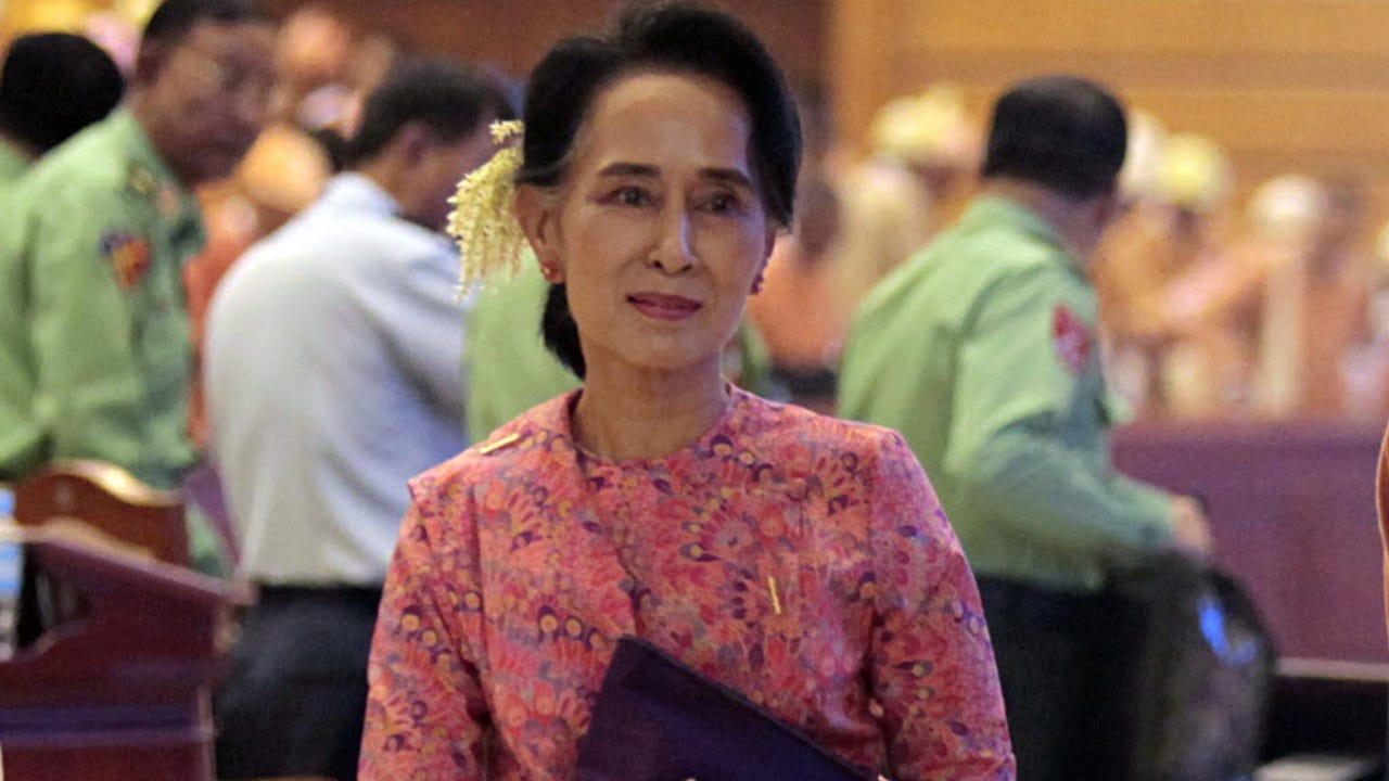Myanmar democracy leader Aung San Suu Kyi leaves after attending the first day of a new parliament session in Naypyitaw, Myanmar, on Feb. 1.