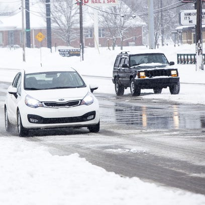 Drivers battled snowy conditions Monday, as seen here,