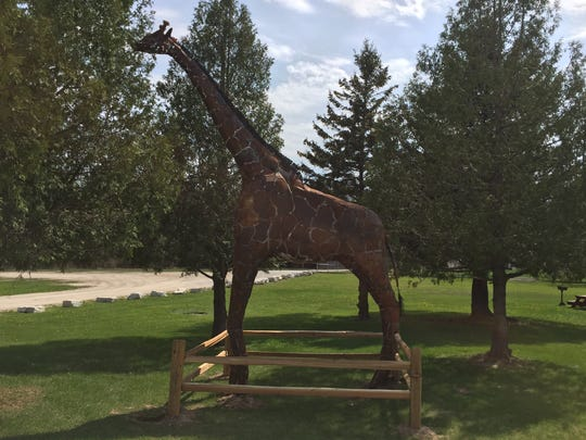 """New to Bruemmer Park Zoo in Kewaunee this year is """"Melvin,"""" a 20-foot-tall metal sculpture of a giraffe created by local business owner Mike Remme."""