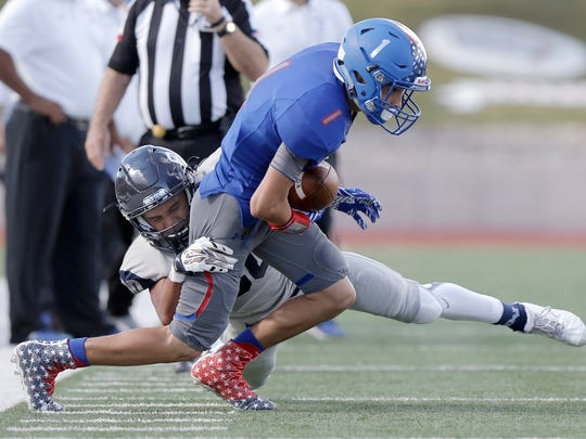 Americas wide receiver Alexis Rubio is hit by Del Valle's