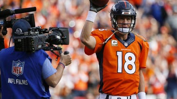 Broncos quarterback Peyton Manning acknowledges the crowd after setting the new passing record against the Kansas City Chiefs during the first half of Sunday's game.