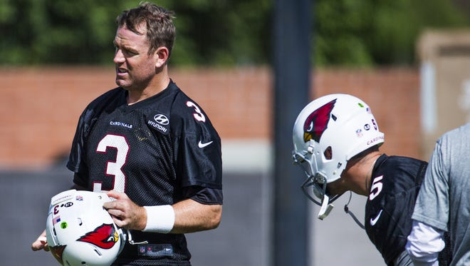 Arizona Cardinals quarterbacks Carson Palmer, left, and Drew Stanton, pause during practice in Tempe, Wednesday, October 12, 2016.