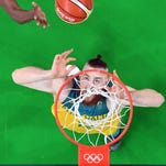 Australia's Aron Baynes eyes a rebound against the United States at the 2016 Summer Olympics in Rio de Janeiro, Brazil, on Wednesday, Aug. 10, 2016.