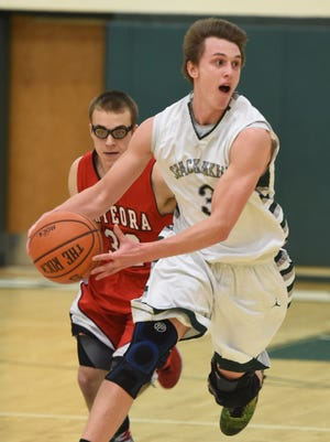 Spackenkill High School's Alex Strom looks to make a move against Onteora at Spackenkill on Jan. 14