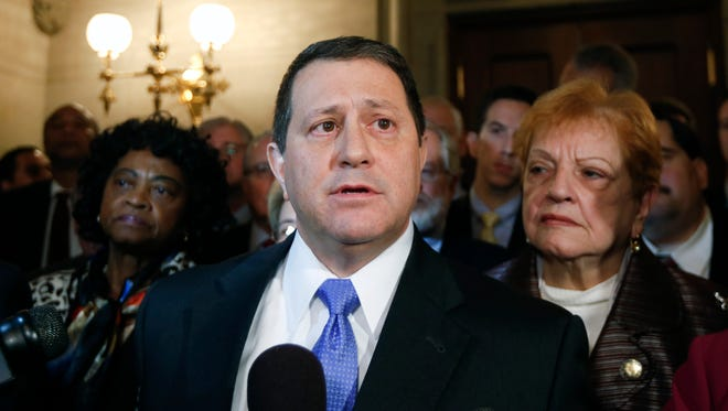 Assembly Majority Leader Joseph Morelle, D-Rochester, with Democratic members of the Assembly behind him, talks to reporters at the Capitol about the arrest of Assembly Speaker Sheldon Silver on Thursday, Jan. 22, 2015, in Albany, N.Y. Silver, who has been one of the most powerful men in Albany for more than two decades, was arrested Thursday on public corruption charges. (AP Photo/Mike Groll)