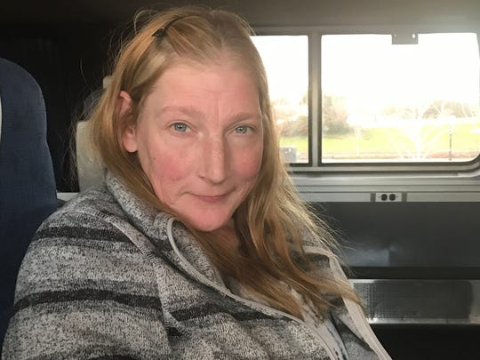 Kim Jozwiak, 53, poses for a portrait on the northbound Coast Starlight train on Dec. 24, 2016. Jozwiak was en route to Olympia, Wash., to see family.