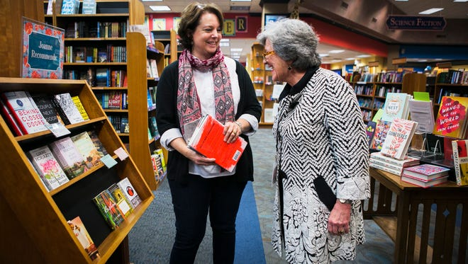 """Wilson Robbins (left), children's coordinator, and Joanne Van Zandt, bookseller, converse as they stand in front of the Joanne Recommends display""""This is my passion. This is my home,"""" Van Zandt said of the bookstore."""