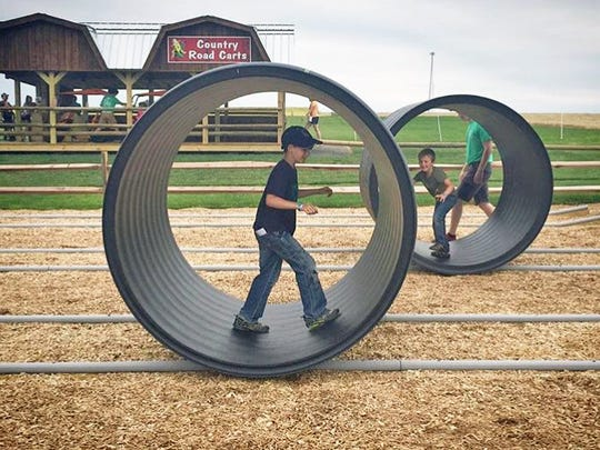 Cherry Crest Adventure Farm's new Round Bale Racer is trickier than it looks as it tests balance and coordination. With four lanes it can also turn into a fun competition among family and friends.