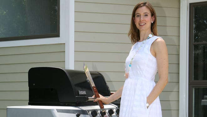 Ilyse Schapiro, a registered dietitian, is pictured with her outdoor grill at her home in Mamaroneck on June 18.