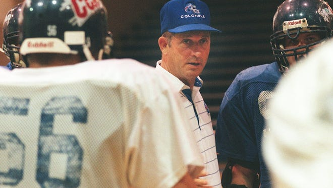 Covington Catholic H.S head football coach Lynn Ray talks to his team inside of the gym at Covington Catholic H.S . in 1999