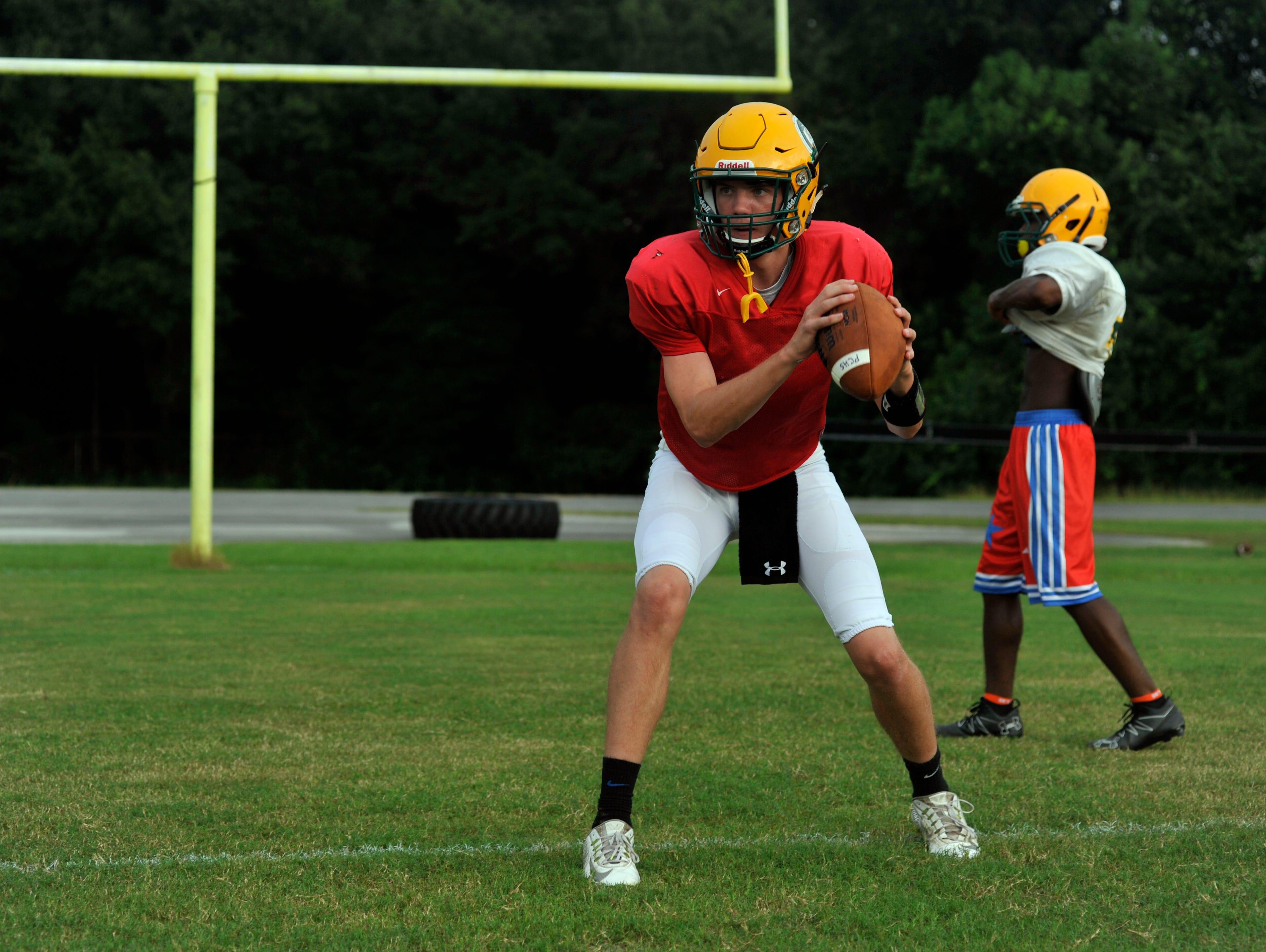 Pensacola Catholic quarterback Garrett Foley takes reps during practice.