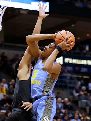 Marquette guard Greg Elliott is fouled by Butler's Aaron Thompson on Wednesday.