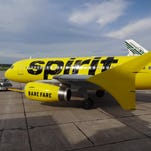 Spirit Airlines unveils its new black-and-yellow livery in Rome, N.Y., on Sept. 15, 2014.