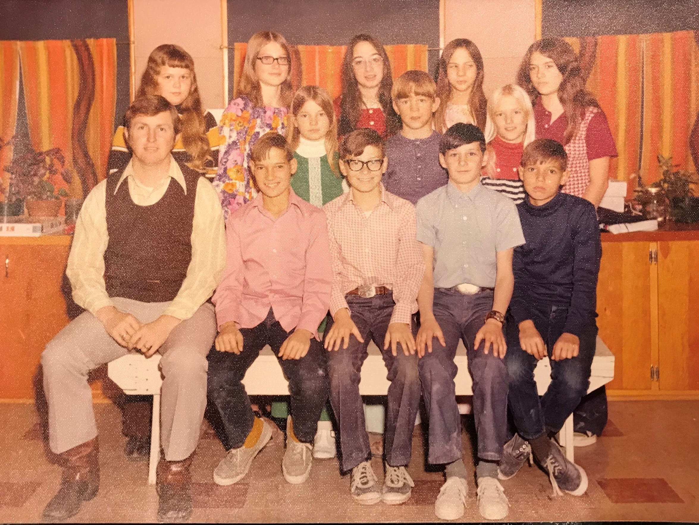 Theresa, back row, second  from left, in a fifth grade