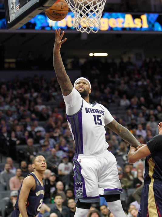 Sacramento Kings center DeMarcus Cousins (15) scores against the New Orleans Pelicans during the second half of an NBA basketball game in Sacramento, Calif., Sunday, Feb. 12, 2017. The Kings won 105-99. (AP Photo/Steve Yeater)